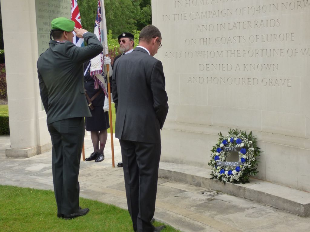 Mark Regev paying his respects to the men who perished