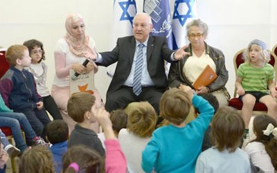 President Rivlin hosts children at a Hand in Hand school for Jewish and Arab students and teachers
