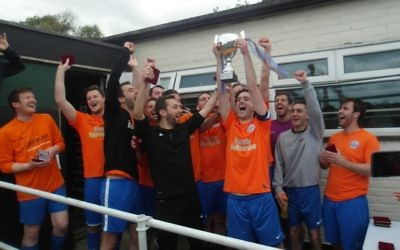 Raiders C's men's team celebrate winning the MMFL/MGBSFL Invitational Trophy.