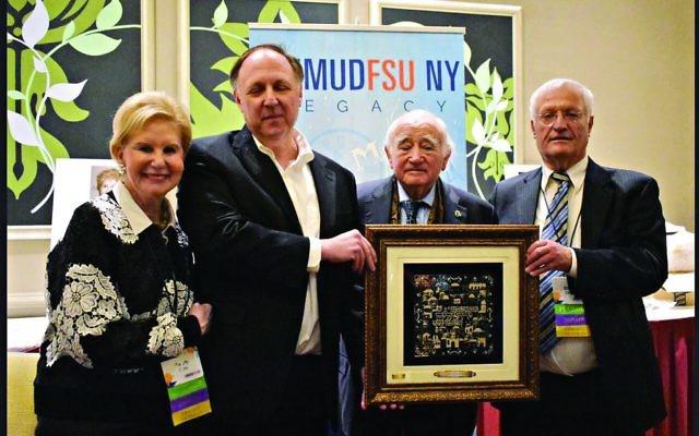 Co-founder Limmud FSU Sandy Cahn, Greg Schneider, Holocaust survivor Roman Kent with his honorary Limmud FSU award, and Chaim Chesler