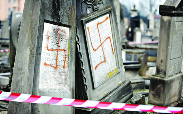 Jewish graves daubed with swastikas