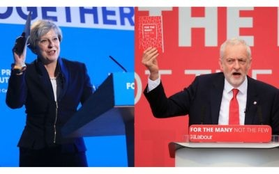 Theresa May and Jeremy Corbyn holding their manifestos