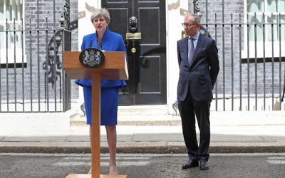 Prime Minister Theresa May, accompanied by her husband Philip, making a statement in Downing Street after she traveled to Buckingham Palace for an audience with Her Majesty the Queen following the General Election results.  Photo credit: Jonathan Brady/PA Wire