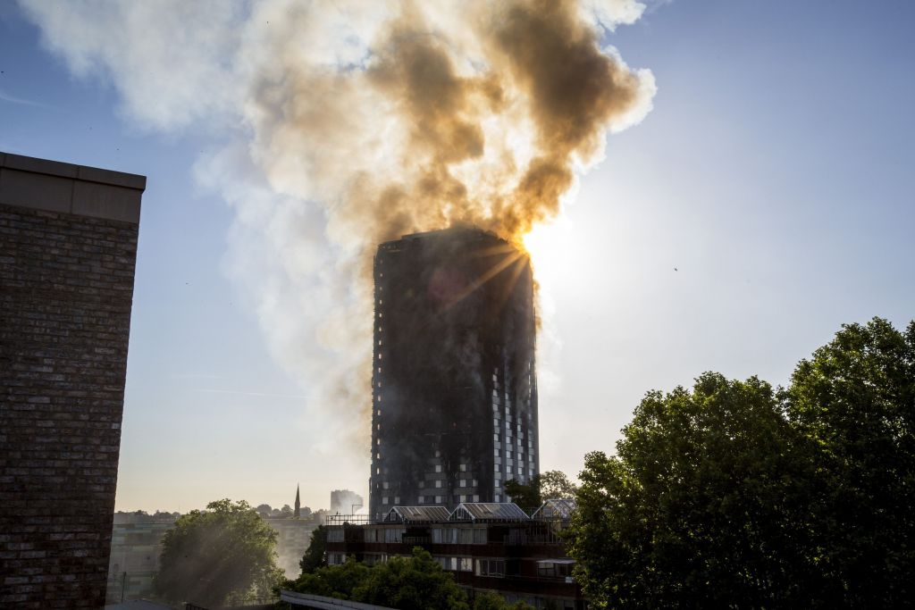 Smoke billows from a fire that has engulfed the 27-storey Grenfell Tower in west London.  Photo credit: Rick Findler/PA Wire