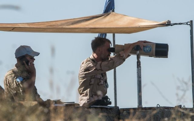 UN officials stationed in the Golan Heights look over into Syria to view the situation  Photo by: Ayal Margolin- JINIPIX