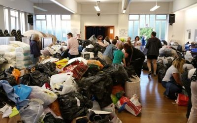 Volunteers sort through items donated to the Grenfell fire relief effort