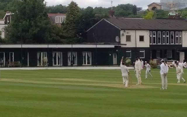 David Kay bowling one of his three overs, which saw him take a wicket