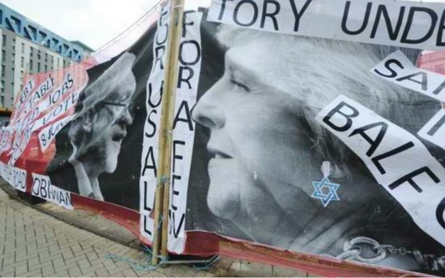 A photo of the banner, featuring Theresa May with a Magen David earring, and the word 'Balfour'  Photo: Jennie Banks/Bristol Post