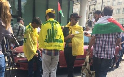 Young men proudly wear the Hezbollah terror flag in central London without fear of arrest.