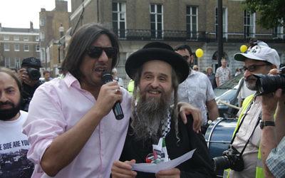 Nazim Ali (left) with an anti-Zionist rabbi from the Neturei Karta
