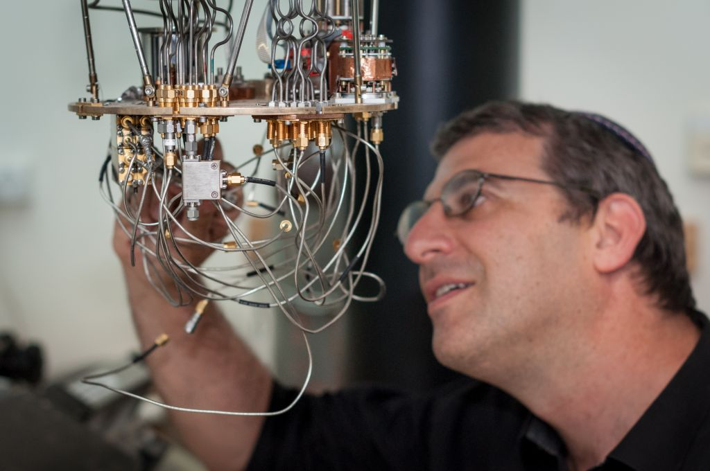 Prof. Nadav Katz with a low temperature setup for testing superconducting detectors at the Hebrew University's Quantum Information Science Center. (Credit: Yitz Woolf for Hebrew University)