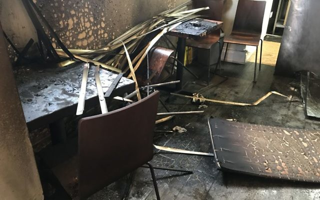 Damage to the JS restaurant  after the arson attack   Photo credit: Steven Allen