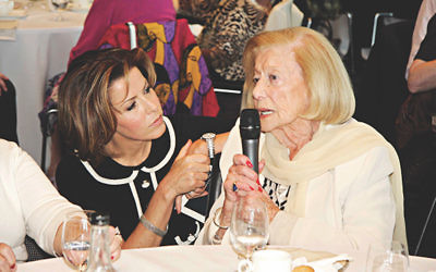 Natasha Kaplinsky listens to survivor Gina Turgel.