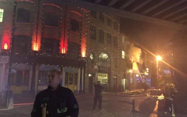 Fire in Camden Market, London.   Photo credit: Dan Ickowitz-Seidler/PA Wire