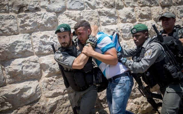 Muslim worshippers  detained by Israeli forces after protesting  outside the Temple Mount, in Jerusalem's Old City.   Photo by: JINIPIX
