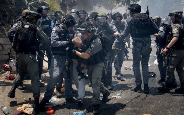 Israeli police clash detaining Palestinian protesters in the East Jerusalem neighbourhood of Wadi el Joz, outside Jerusalem's Old City, following Friday prayers on July 21, 2017.   Photo by: JINIPIX