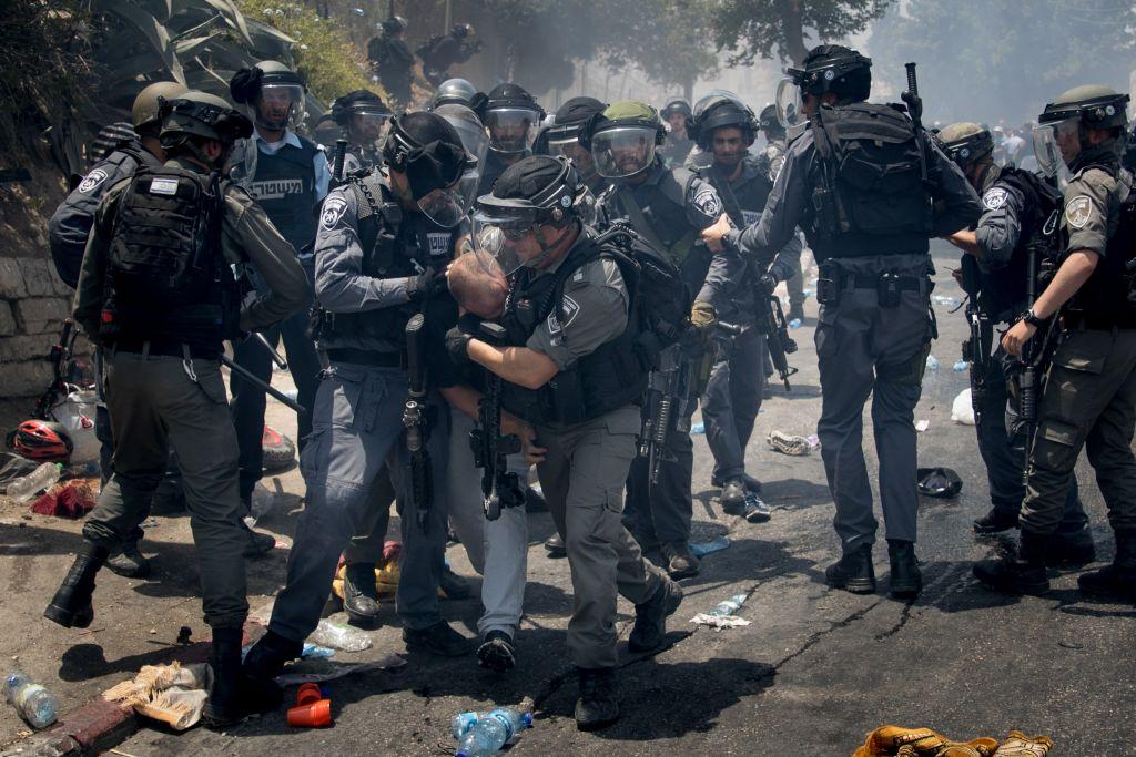 Israeli police clash with Palestinian protesters in the East Jerusalem neighborhood of Wadi el Joz, outside Jerusalem's Old City, following Friday prayers on July 21, 2017.  Photo by: JINIPIX