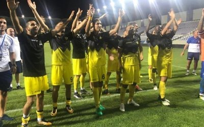 Beitar Jerusalem celebrate their win on Thursday evening