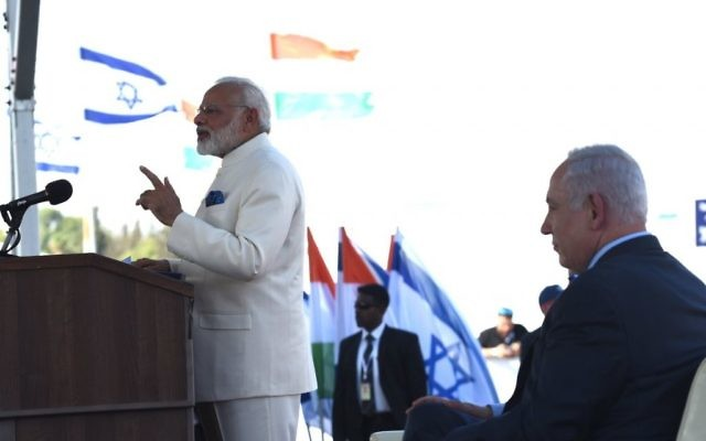 Narendra Modi speaking as Israeli leader Benjamin Netanyahu looks on