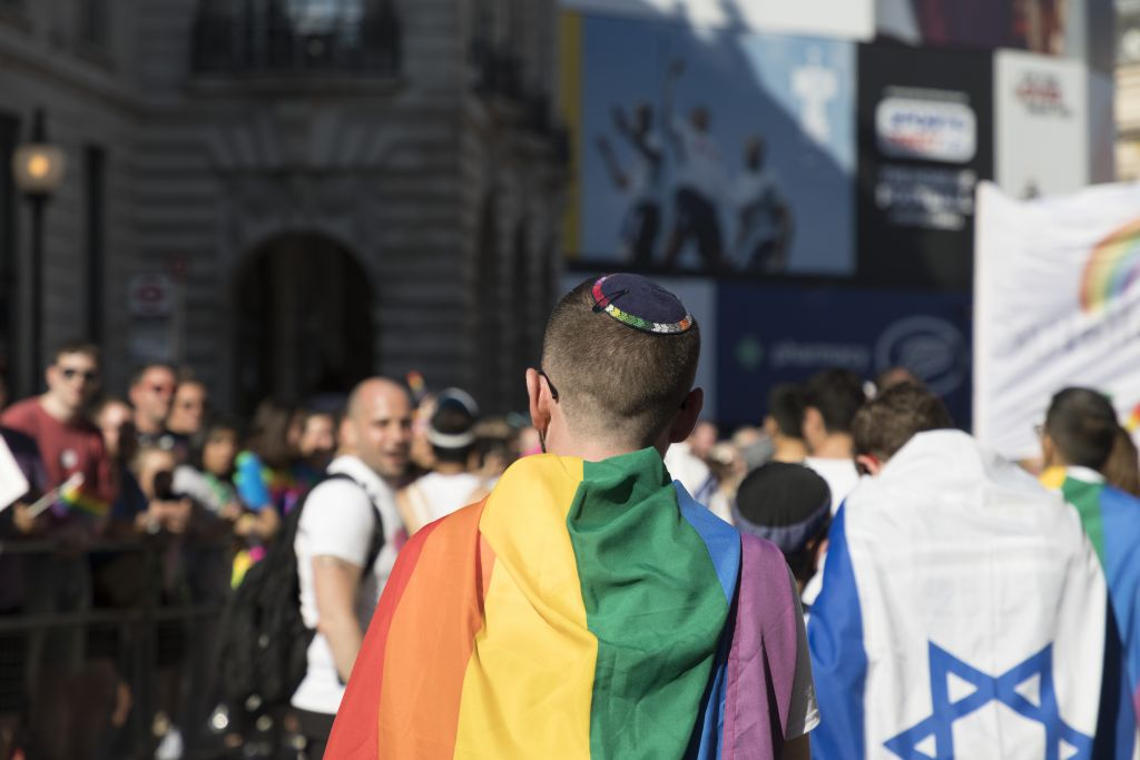 Pride participants wore Jewish Rainbow flags, whilst others brought Israeli flags Credit - Gilad Visotsky