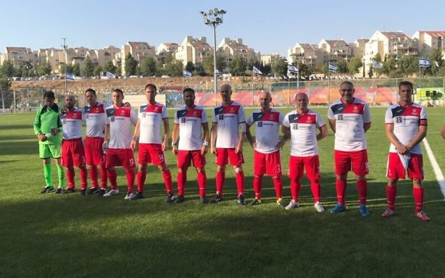 The Masters 45+ team lining up ahead of kick-off against Chile