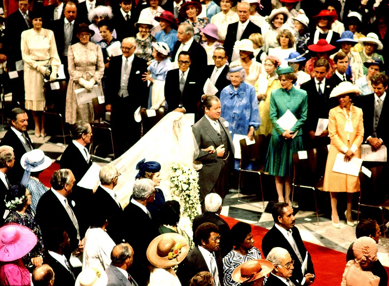 Diana Spencer walks up the aisle at her wedding to Charles as Camilla Parker Bowles (third row) looks on
