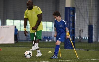 Rio with his coach Bamgbopa Abayomi Alabai (AKA Yomi). Picture: Photo Credit: Maciej Gillert/mediapictures.pl