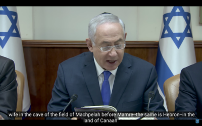 Benjamin Netanyahu wears a kippah as he reads a passage of the bible during a weekly cabinet meeting