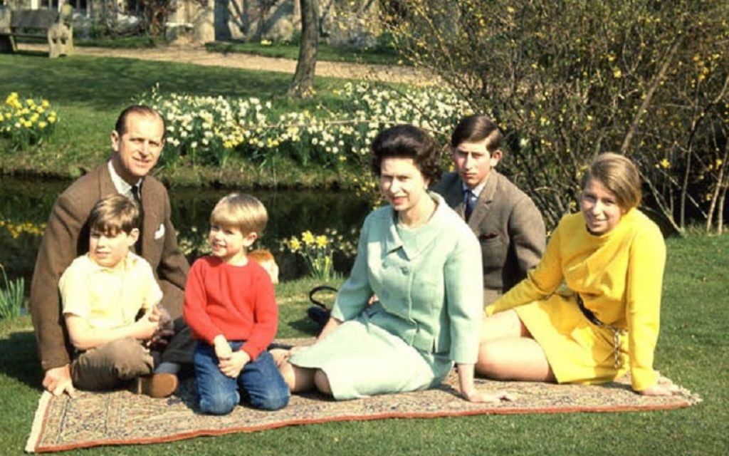 The Queen and her family pictured on a Persian rug at Windsor