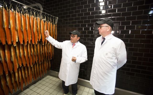 Lance Forman with Michael Gove, inspecting smoked salmon