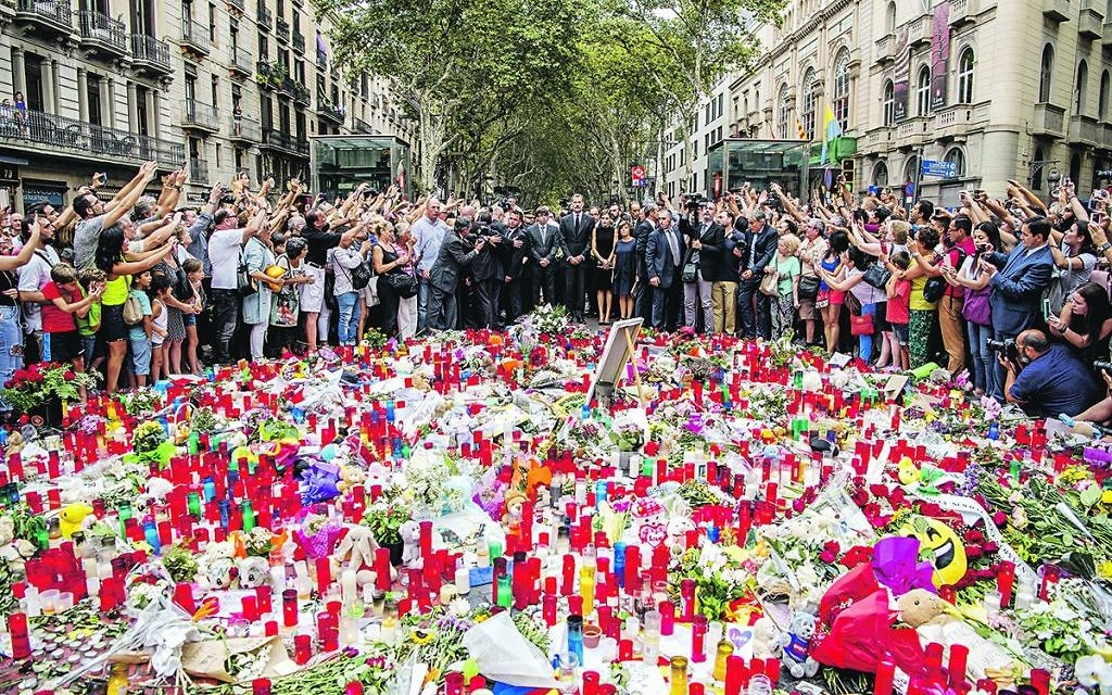 Mourners in Barcelona paying tribute to those murdered in the recent terrorist attack