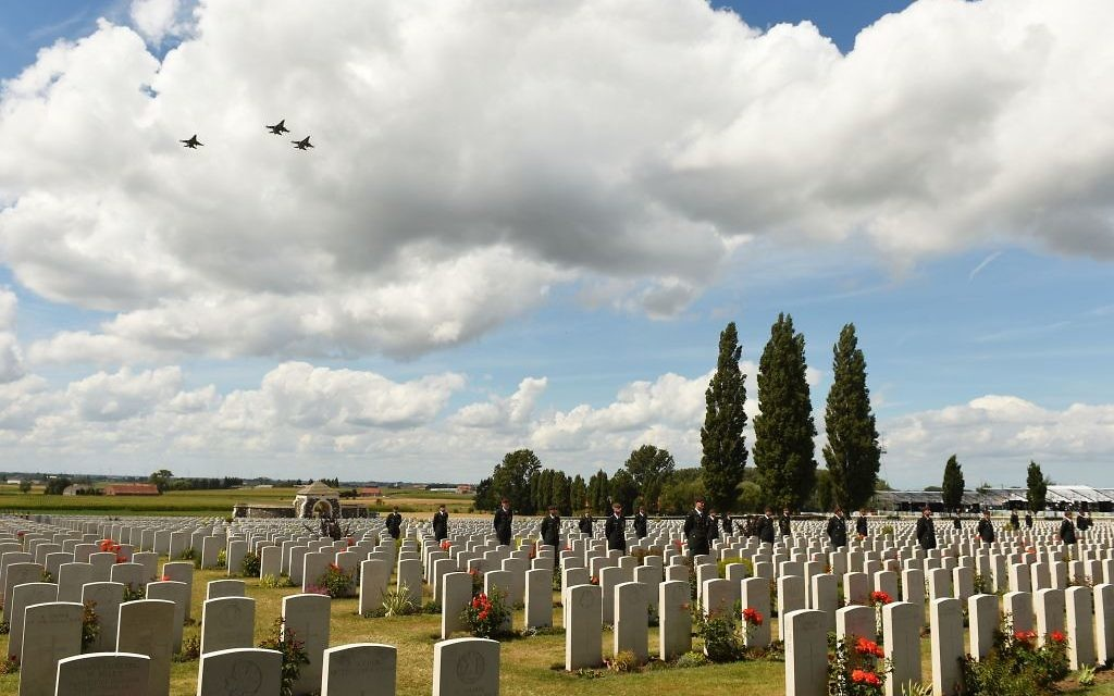 Jets perform a fly-past over Tyne Cot Commonwealth cemetery in Belgium, honouring thousands who died.