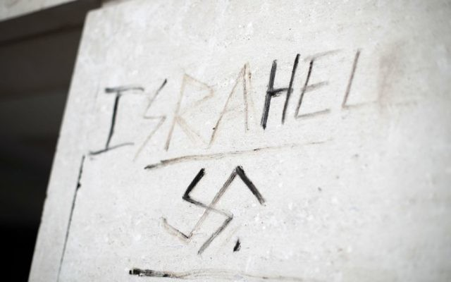 Graffiti saying 'Israhell' next to a swastika on a wall in Victoria, London.   Photo credit: Yui Mok/PA Wire