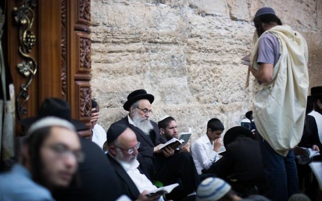Charedi men pray at the Western Wall in the Old City of Jerusalem  Photo by: JINIPIX