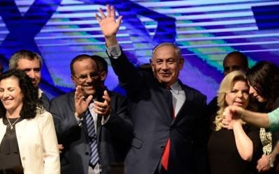 Prime Minister Benjamin Netanyahu with his wife Sara and Likud party members at a rally in his support, as he and his wife face legal investigations, in Tel Aviv  Photo by Tomer Neuberg- JINIPIX
