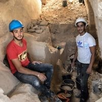Employees of the Israel Antiquities Authorities (IAA) work during archaeological excavations in a newly discovered small cave at the Arab town of Reina in Galilee. The excavations at the ancient site uncovered a 2,000-year-old workshop for the production of stone vessels, including remains of chalkstone mugs and bowls.   Photo by: Gil Eliyahu - JINIPIX