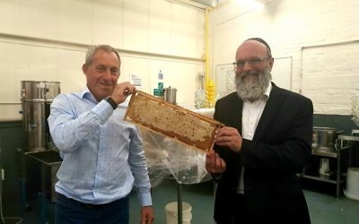 Honeymaker, Warren Bader (l) having his kosher credentials checked by a member of the KLBD