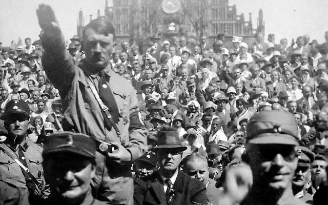 Hitler and Hermann Göring saluting at a 1928 Nazi Party rally in Nuremberg