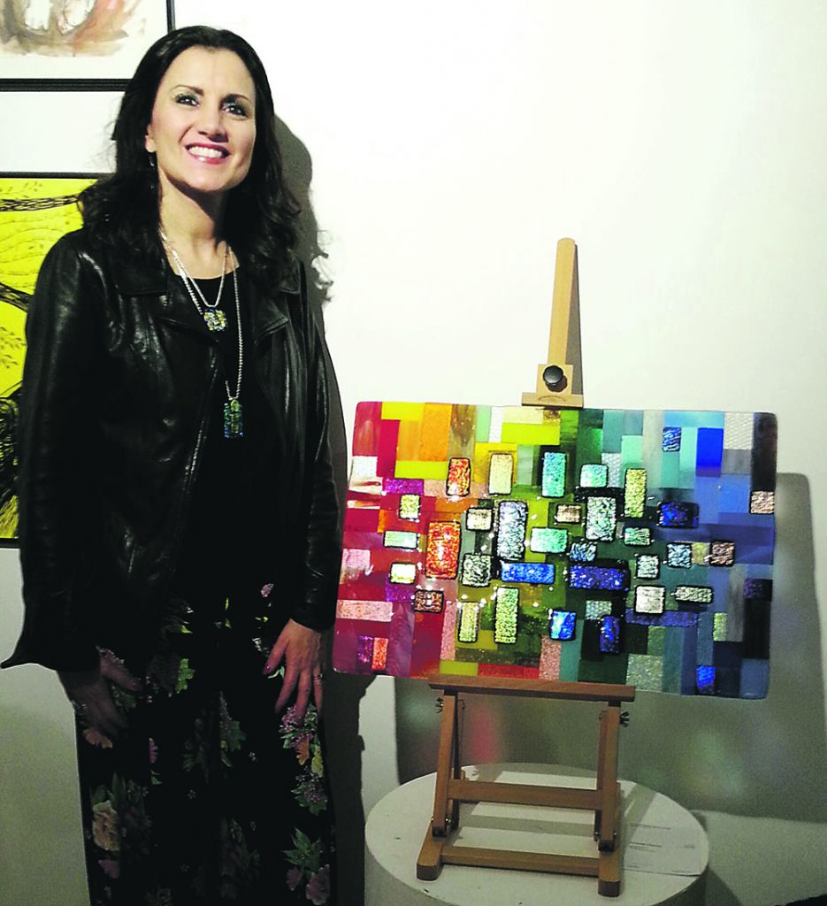 Artist Amanda Charles with her work, entitled My Happy Place