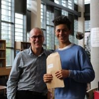 A JCoSS student celebrates results with headteacher Patrick Moriarty