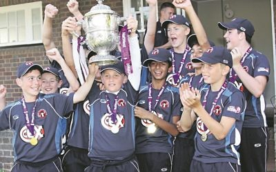 Captain Oliver White lifts the cup, Ben is pictured second row, second from left