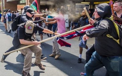 Far-right protestors and anti-fascist demonstrators clash in Charlottesville, Virginia, in August.