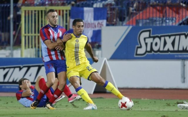 Eyal Golasa (yellow) in action for Maccabi Tel Aviv during their match against Panionios on Thursday. Picture: MTA