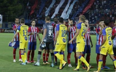 Players from Panionios and Maccabi Tel Aviv line-up ahead of last week's kick-off - including Iranian Ehsan Hajsafi (number 28 in striped shirt). Picture: MTA