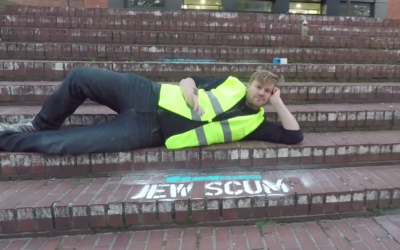 Shahak Shapira outside Twitter HQ with graffiti on the pavement reading 'Jew scum'