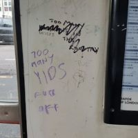 "Anti-Semitic graffiti at a bus stop reads: ""Too many yids, f*** off.""  Photo credit: @Shomrim"