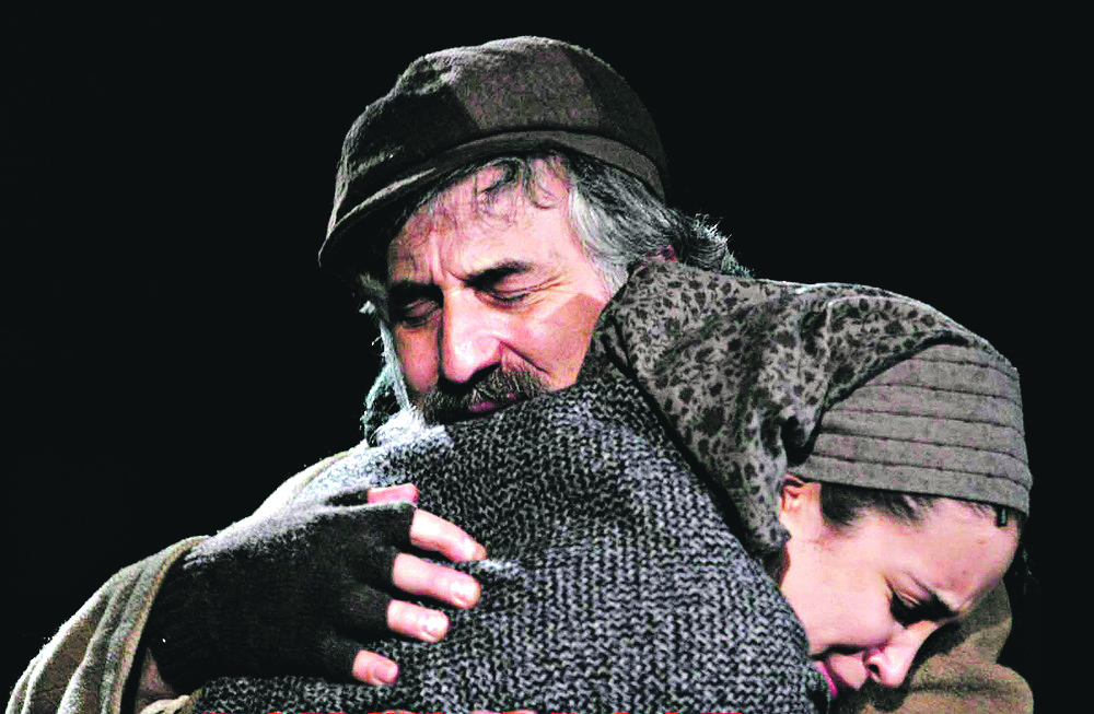Alexandra, as Hodel, embraces her father Tevye, played by Henry Goodman
