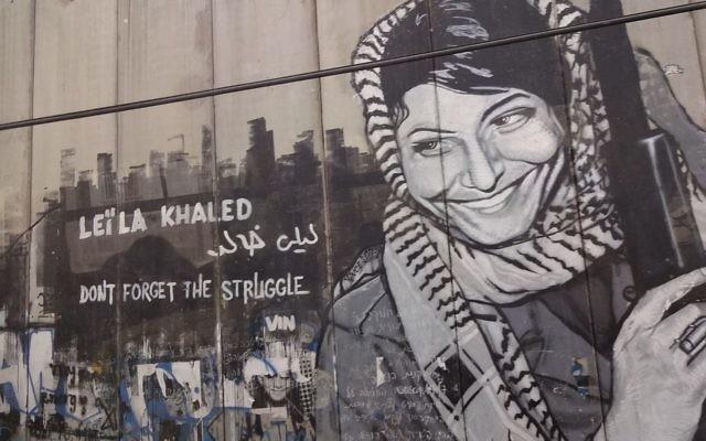 Leila Khaled graffiti on the Israeli West Bank barrier near Bethlehem.