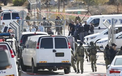 Israeli security deploys at an entrance to Har Adar settlement near Jerusalem, after a Palestinian assailant opened fire killing three Israeli men and critically wounding a fourth.   (AP Photo/Mahmoud Illean)