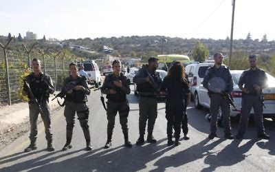 Israeli police blocks the road to Har Adar settlement near Jerusalem after Nimr Mahmoud Ahmed Jamal, a Palestinian attacker opened fire at the entranc killing three Israeli men and critically wounding a fourth.   (AP Photo/Mahmoud Illean)